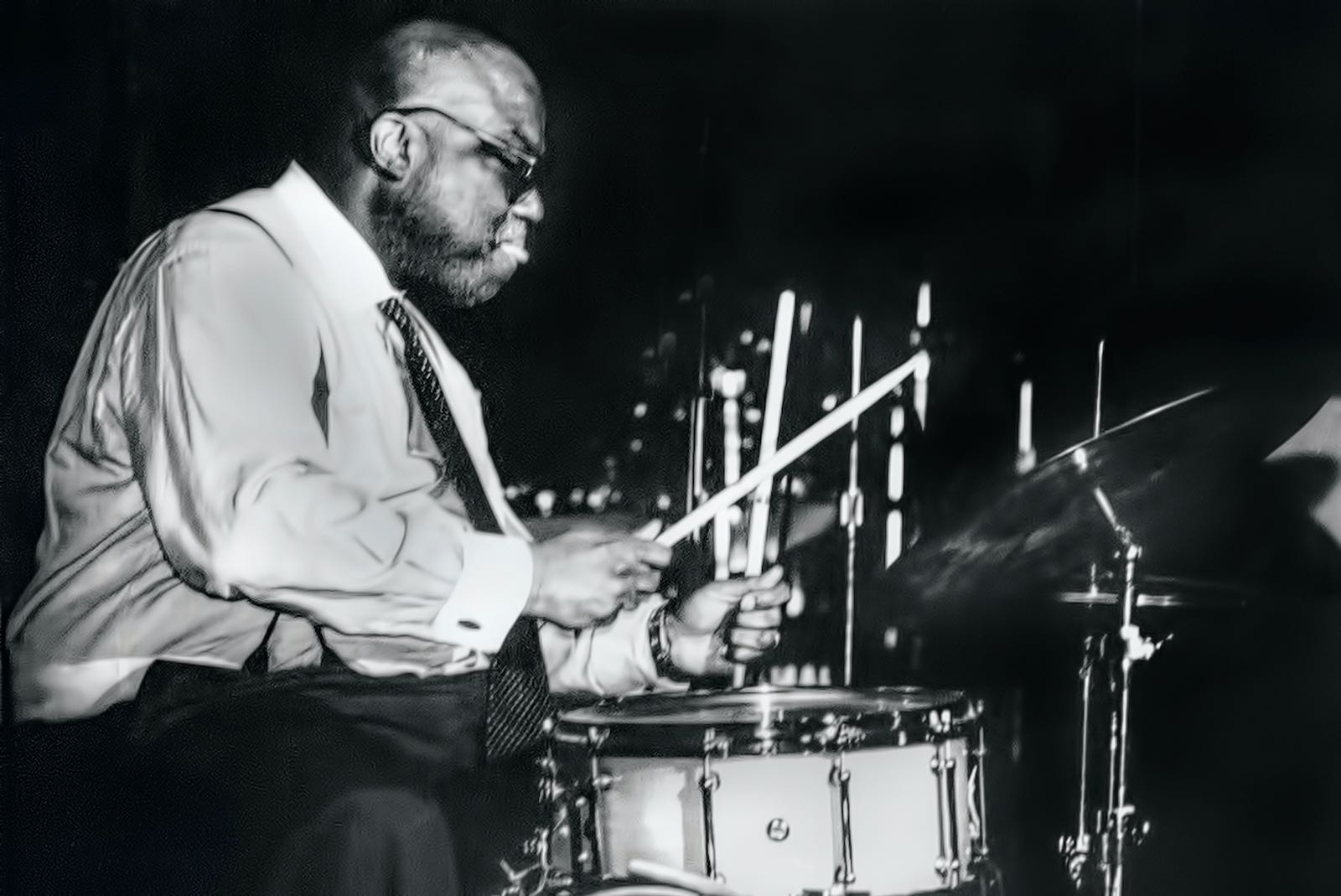 Stanley Crouch playing drums, 2004
