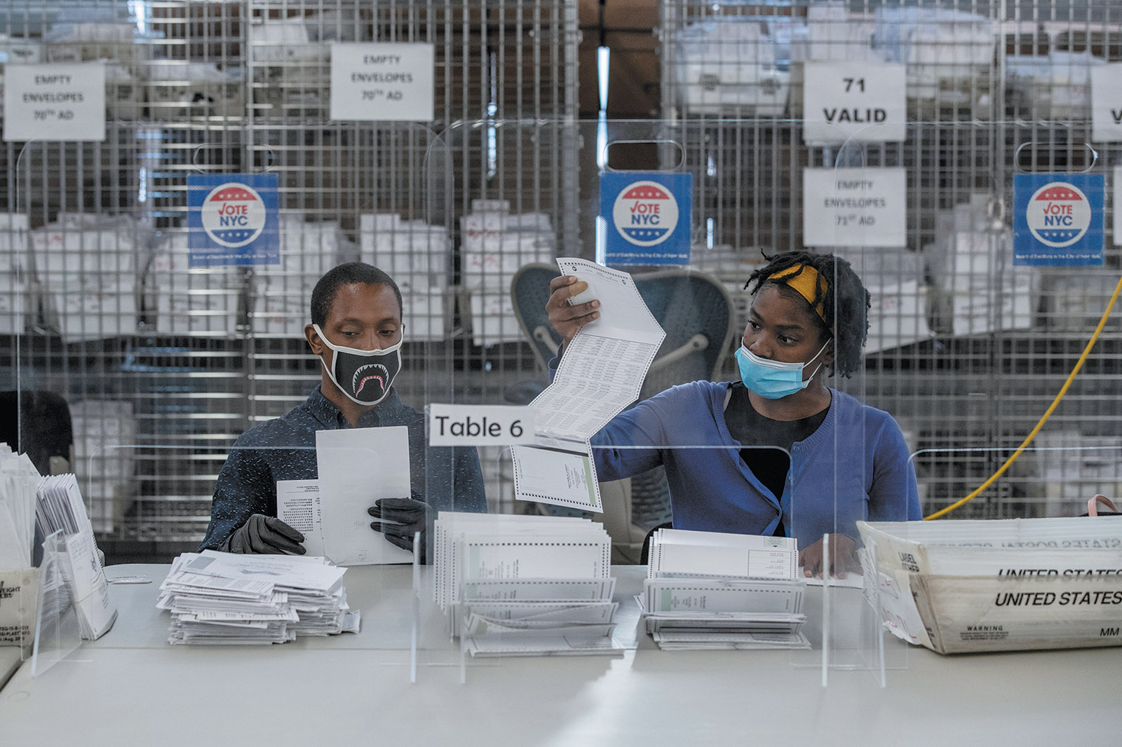 Board of Elections workers counting absentee ballots