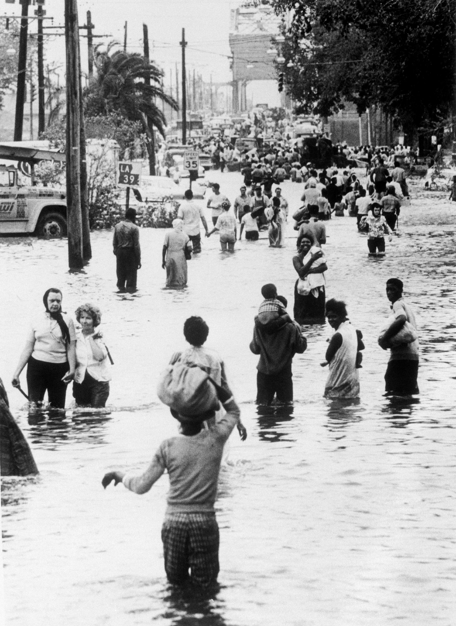People evacuating flooded areas after Hurricane Betsy, New Orleans
