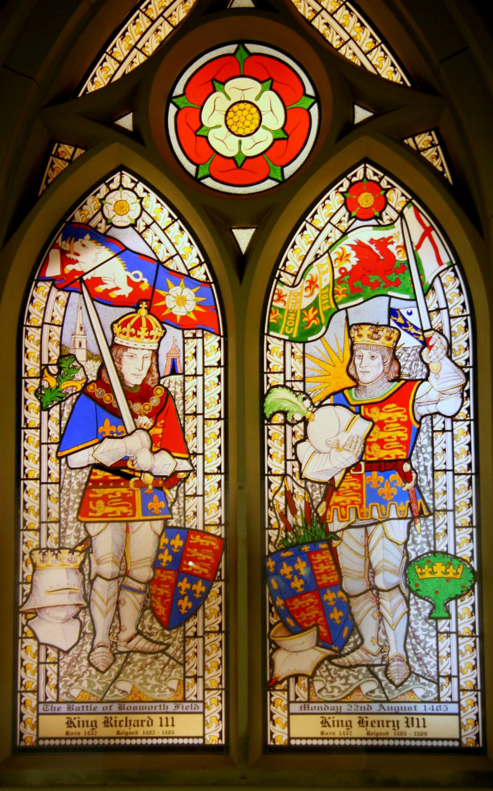 A stained glass window depicting Richard III and Henry VII in St. James Church