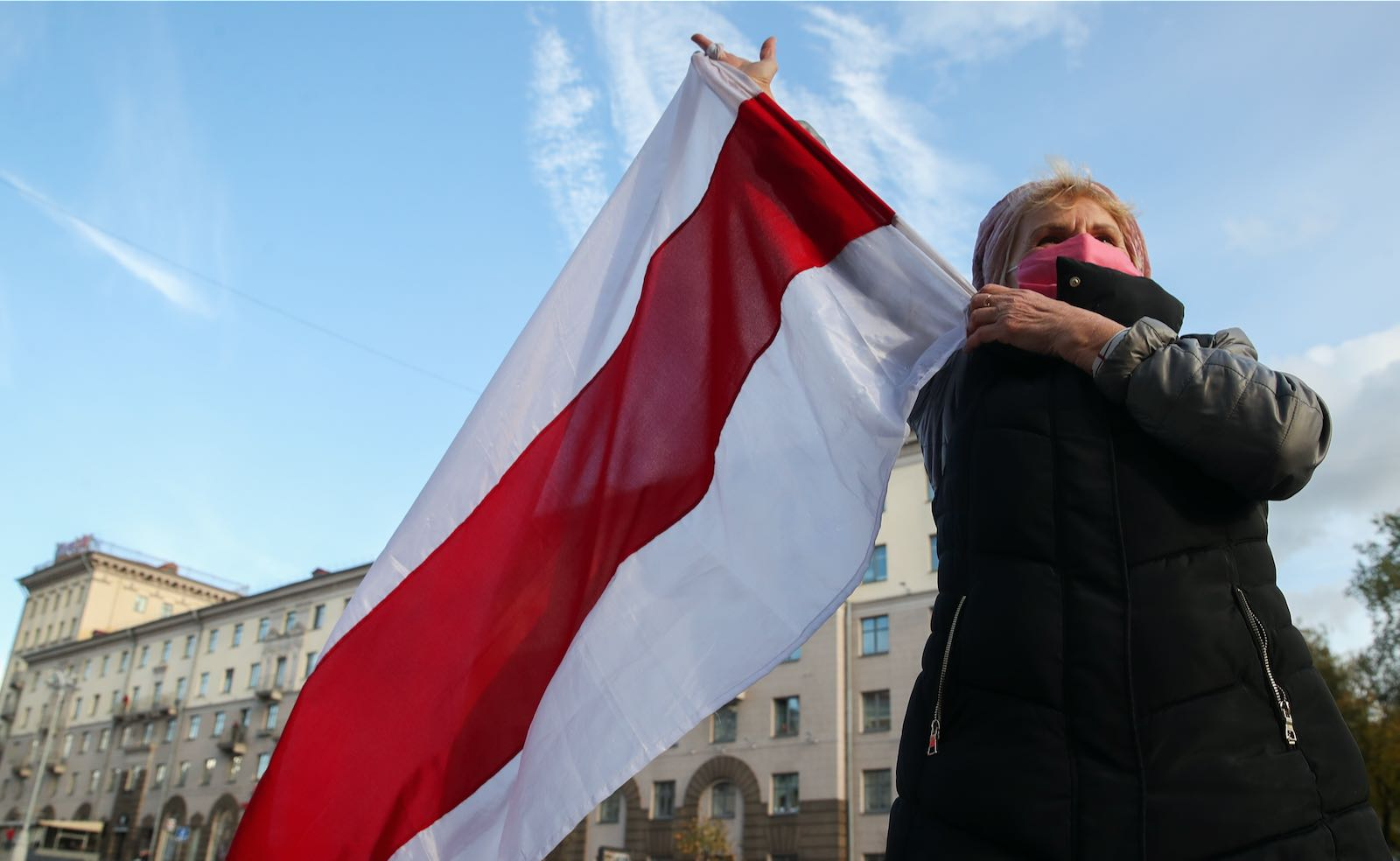 Protester waving flag in Minsk, Belarus