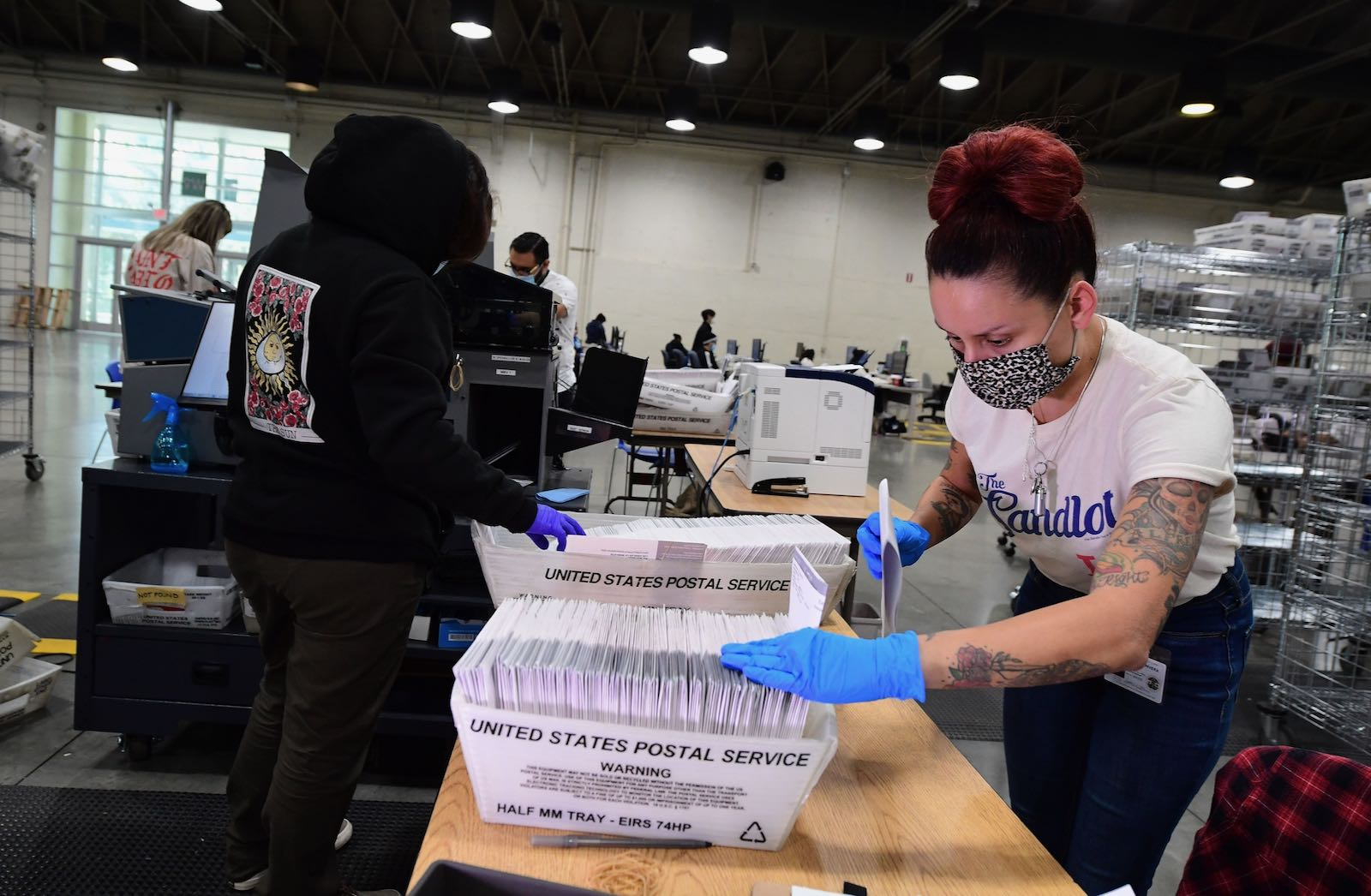 Election workers preparing mail-in ballots