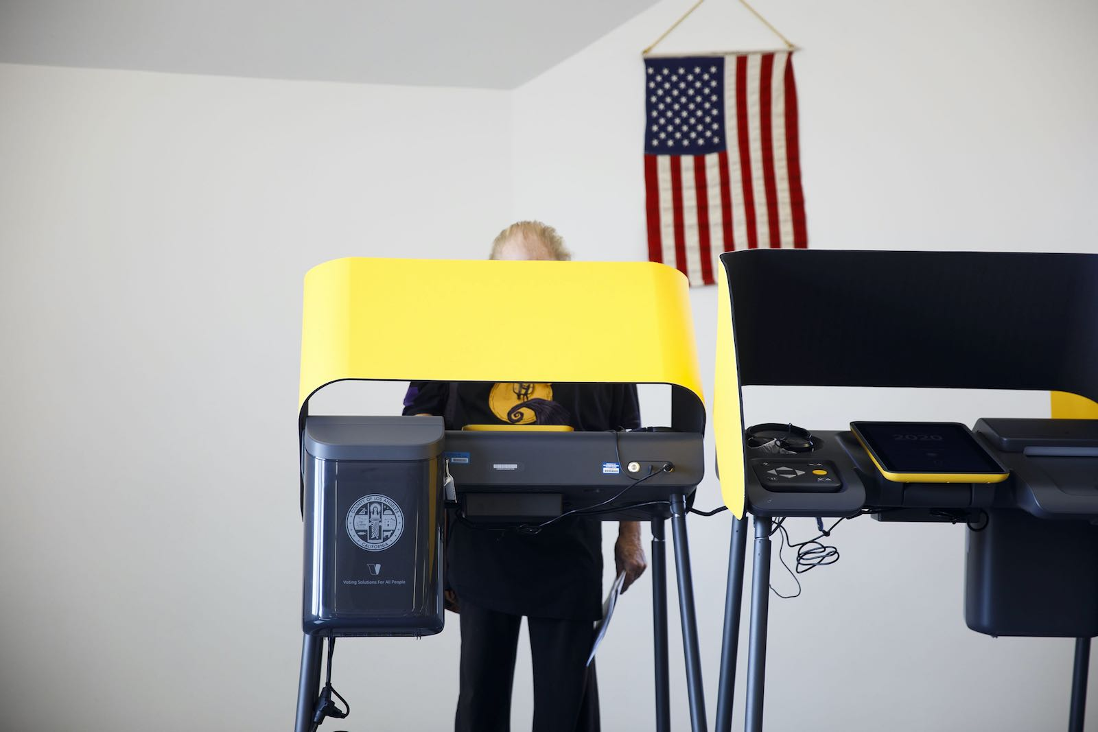A voter casting a ballot on an electronic device
