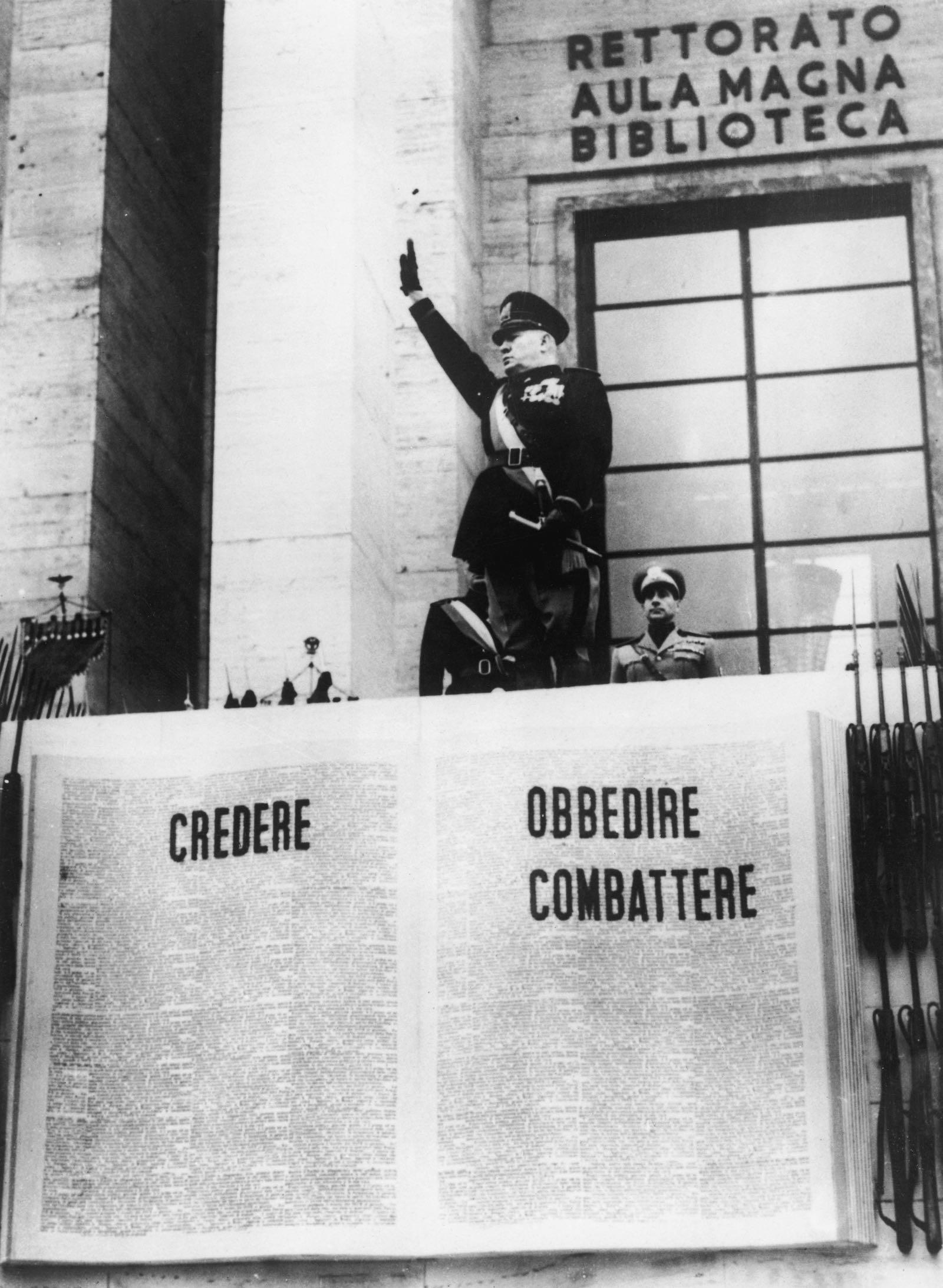 Benito Mussolini saluting