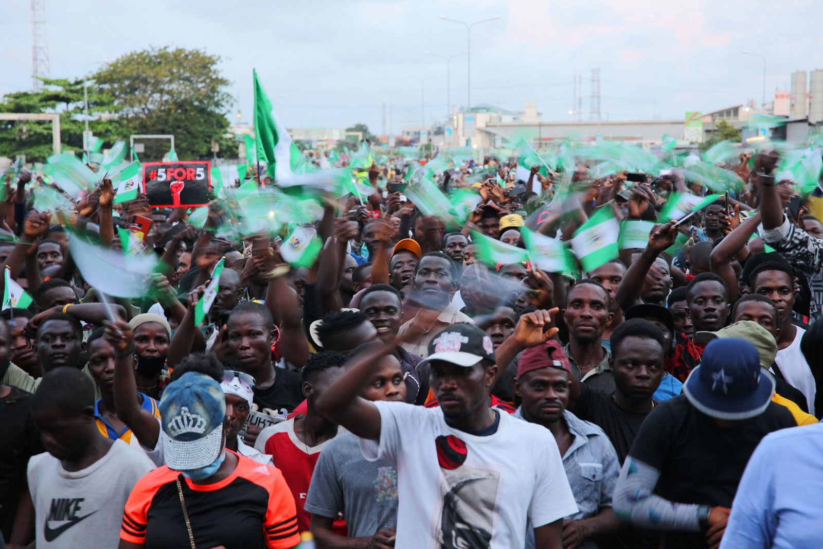 Protestors in Lagos, Nigeria, wave Nigerian flags for the #EndSARS movement against police brutality