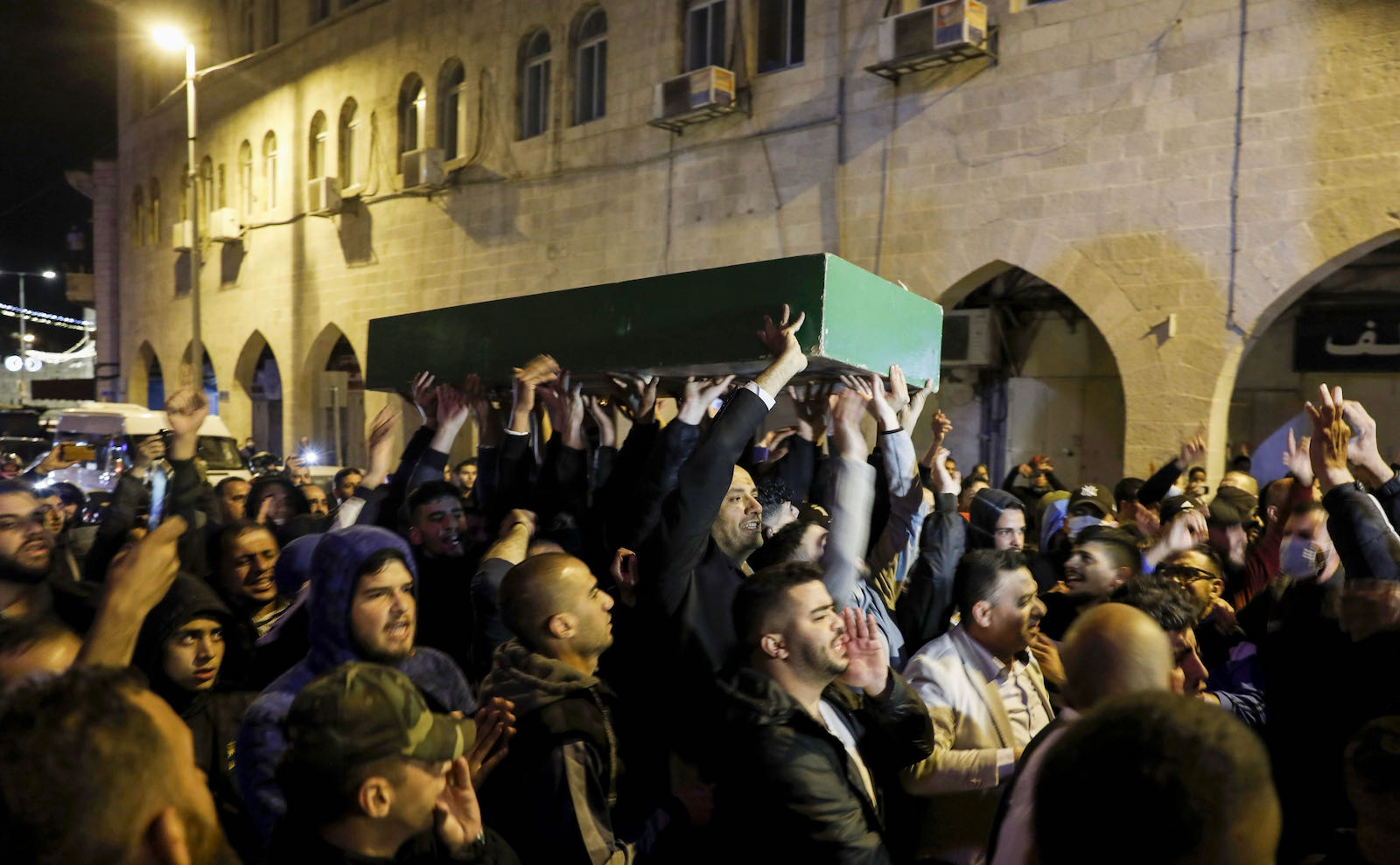 Angry Palestinian mourners carrying the coffin of Eyad al-Hallaq