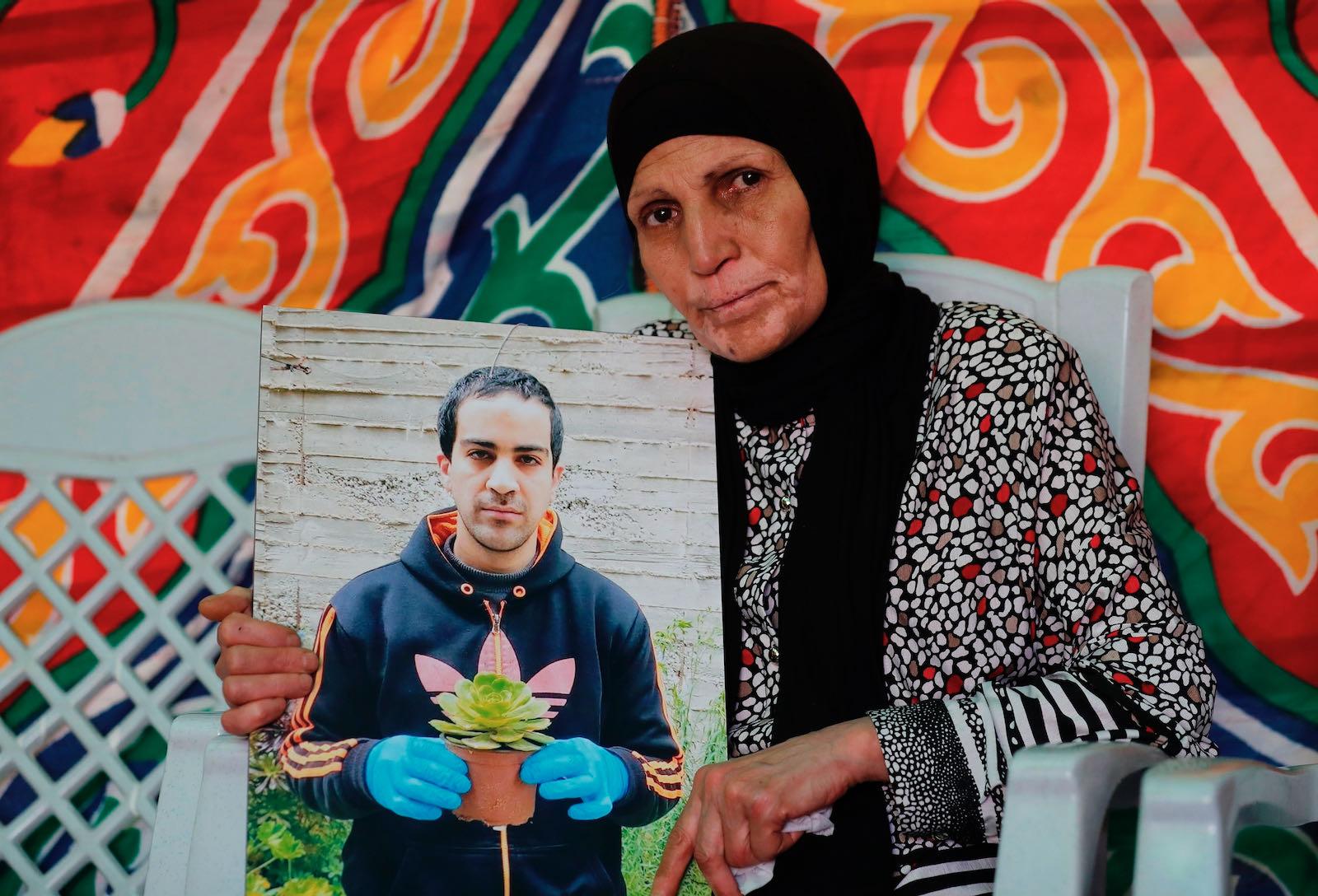 Rana al-Hallaq mourning her son, Eyad