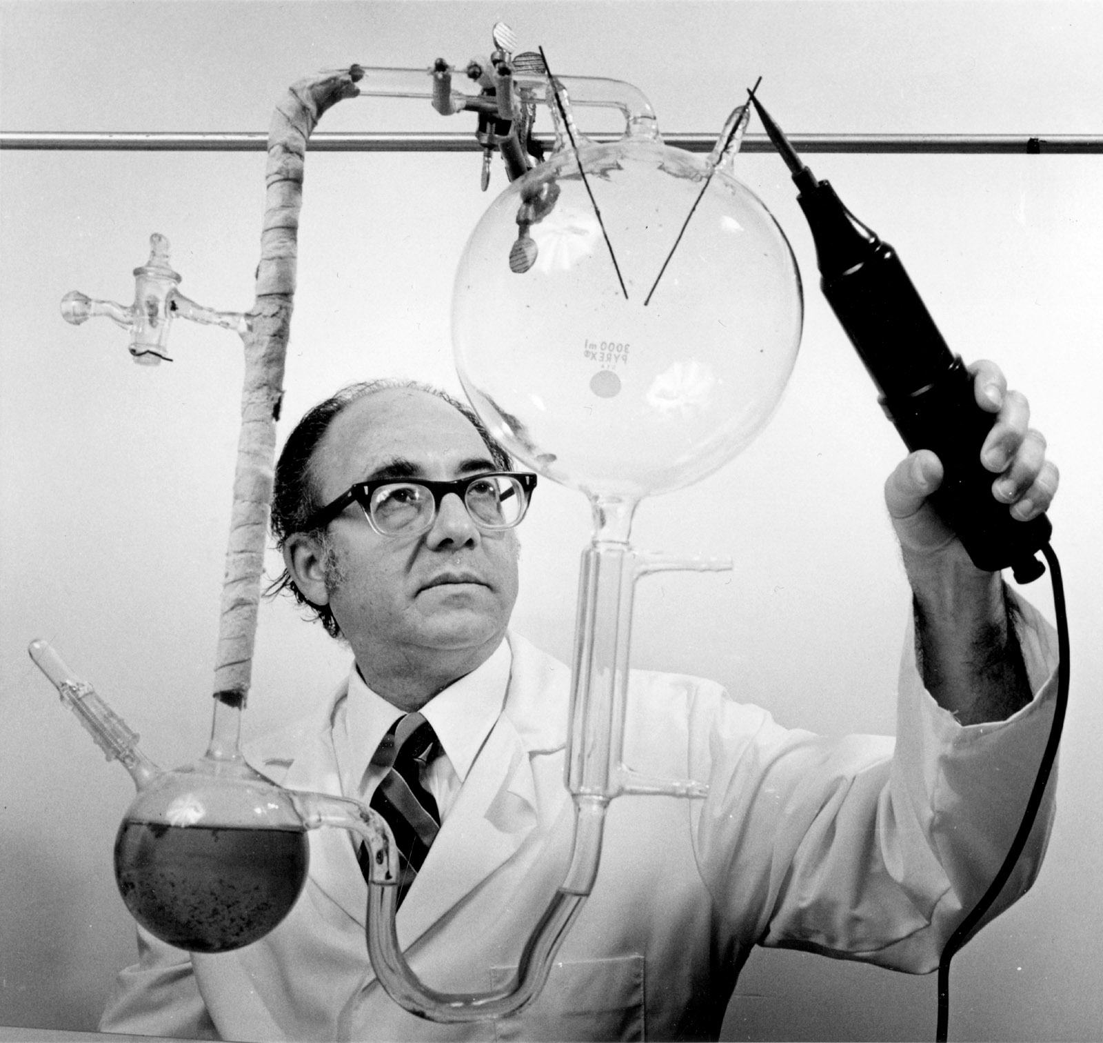 Stanley Miller conducting the Miller-Urey Experiment, designed to test the idea that the fundamental elements of life could be assembled in a 'primordial soup'