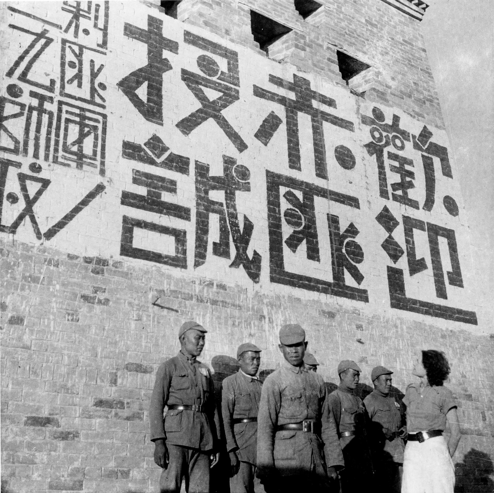 Helen Foster Snow with a group of Manchurian soldiers who had joined Mao's Red Army, Shaanxi province, China