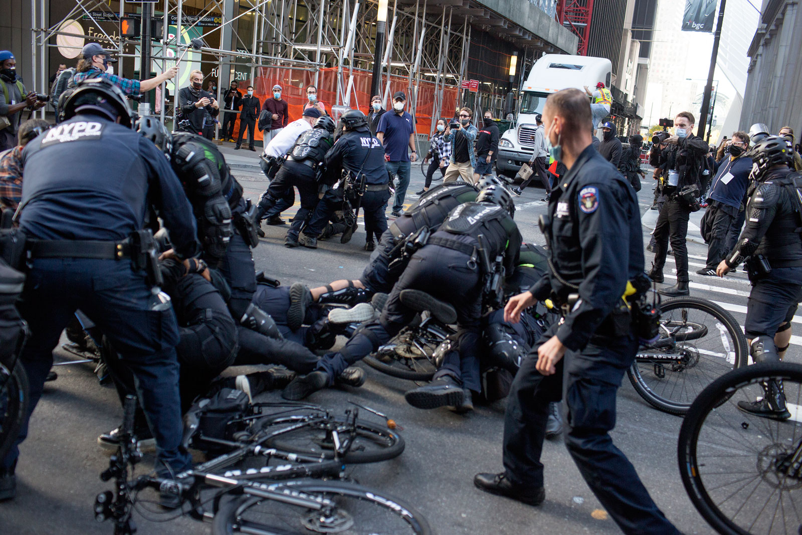 NYPD officers with bikes, wrestling protestors to the ground in New York