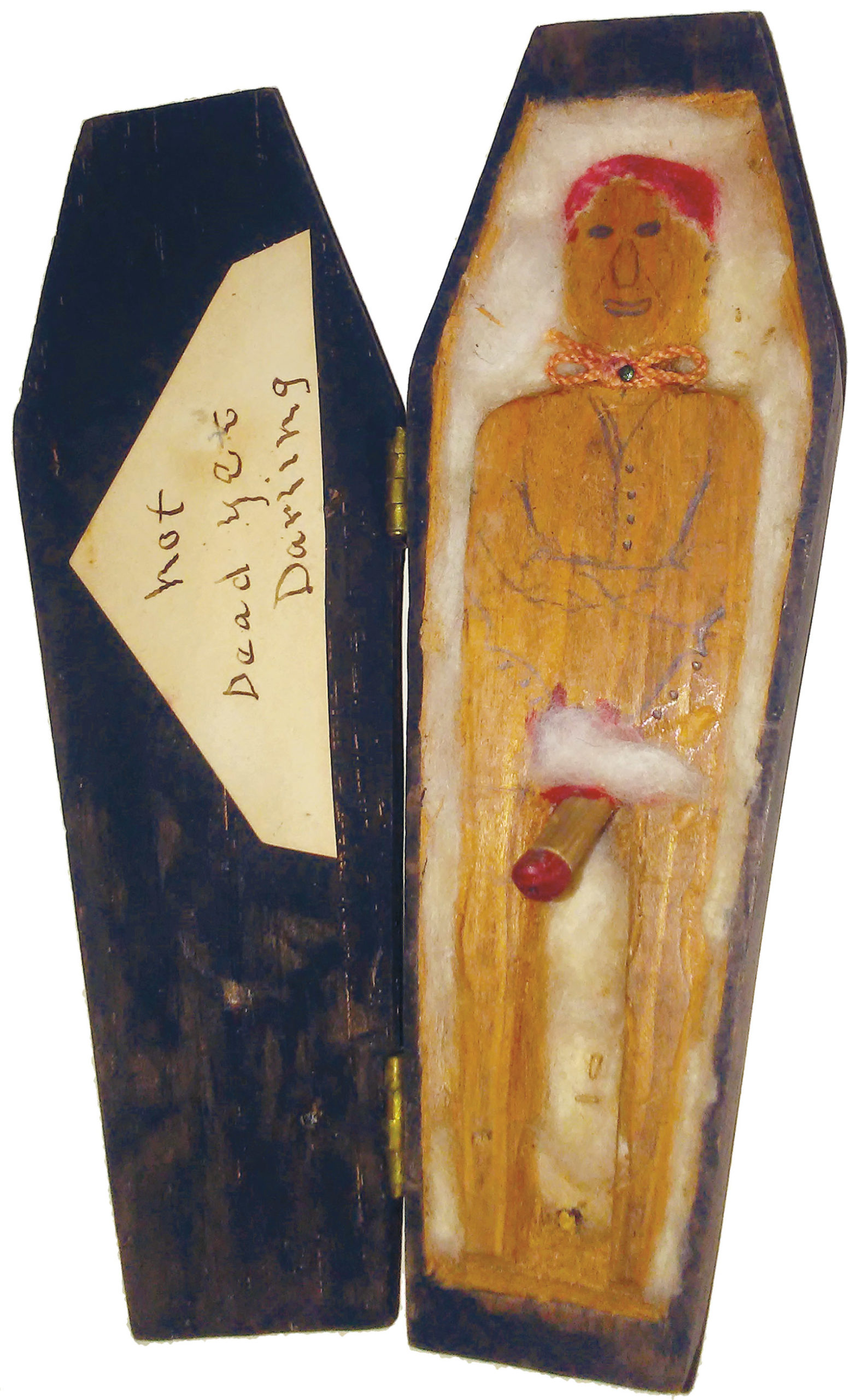 A toy coffin with the inscription Not Dead Yet Darling, circa 1930