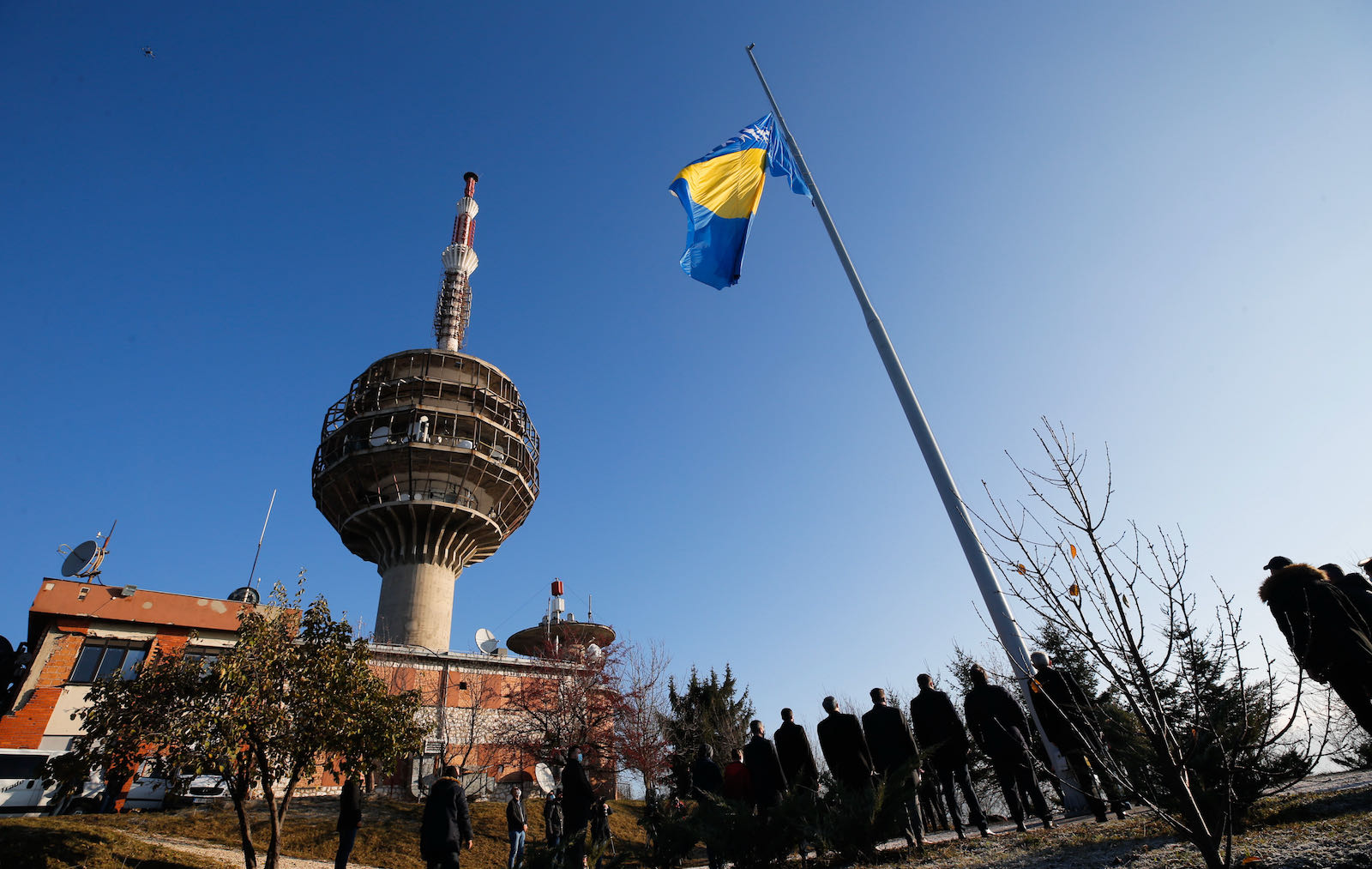 A Bosnian flag being raised