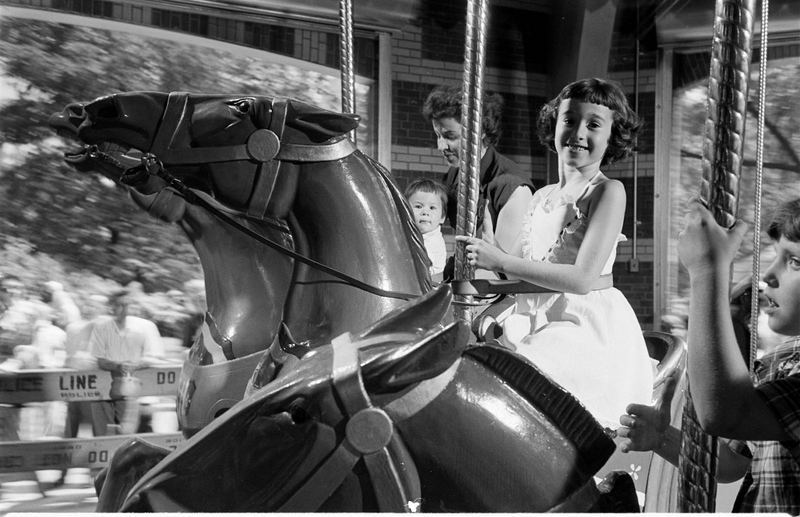 Children riding the carousel in Central Park