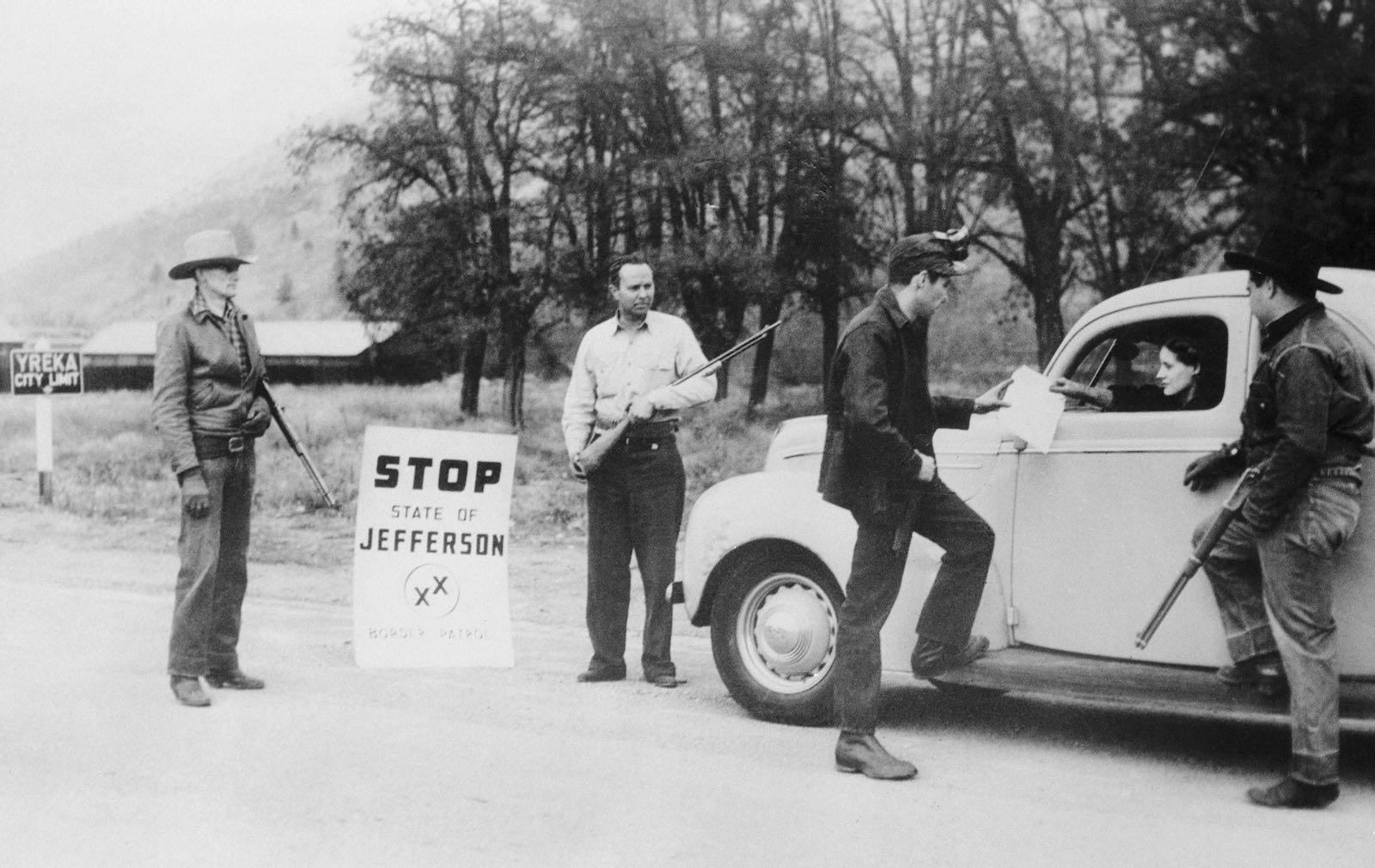 Militiamen stopping a motorist
