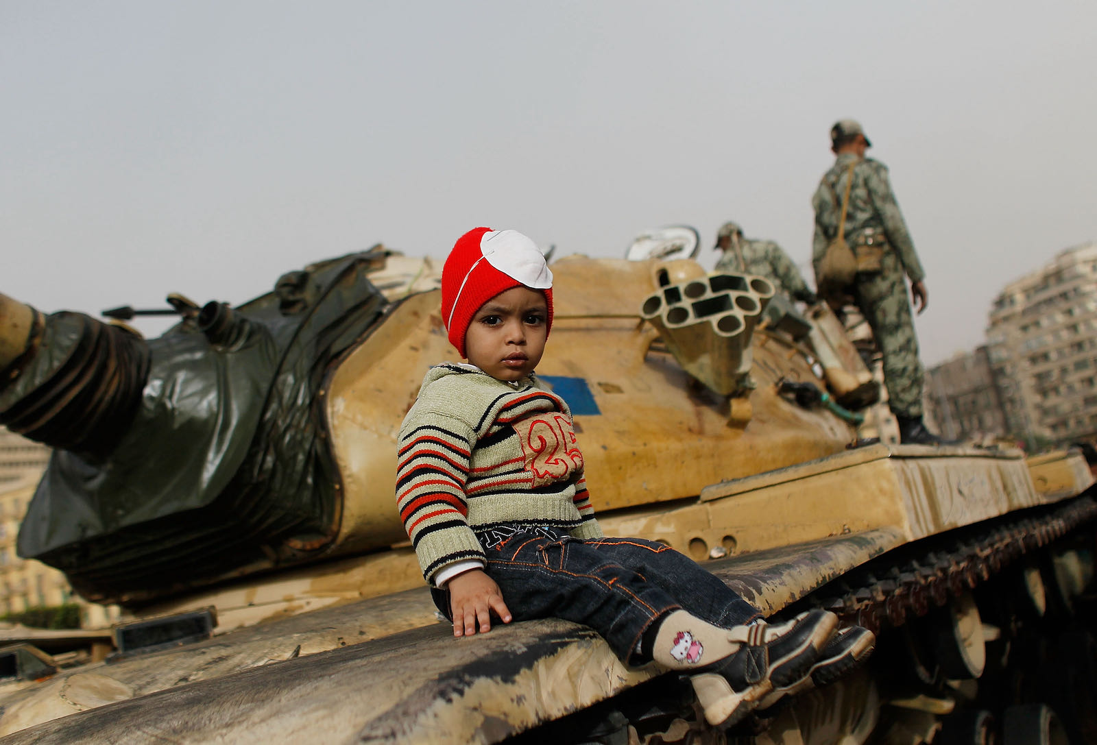 A child sitting on a tank