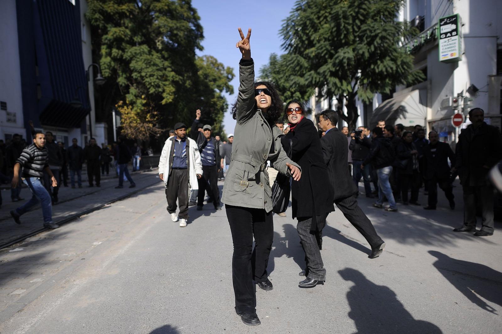 A Tunisian demonstrator gesturing