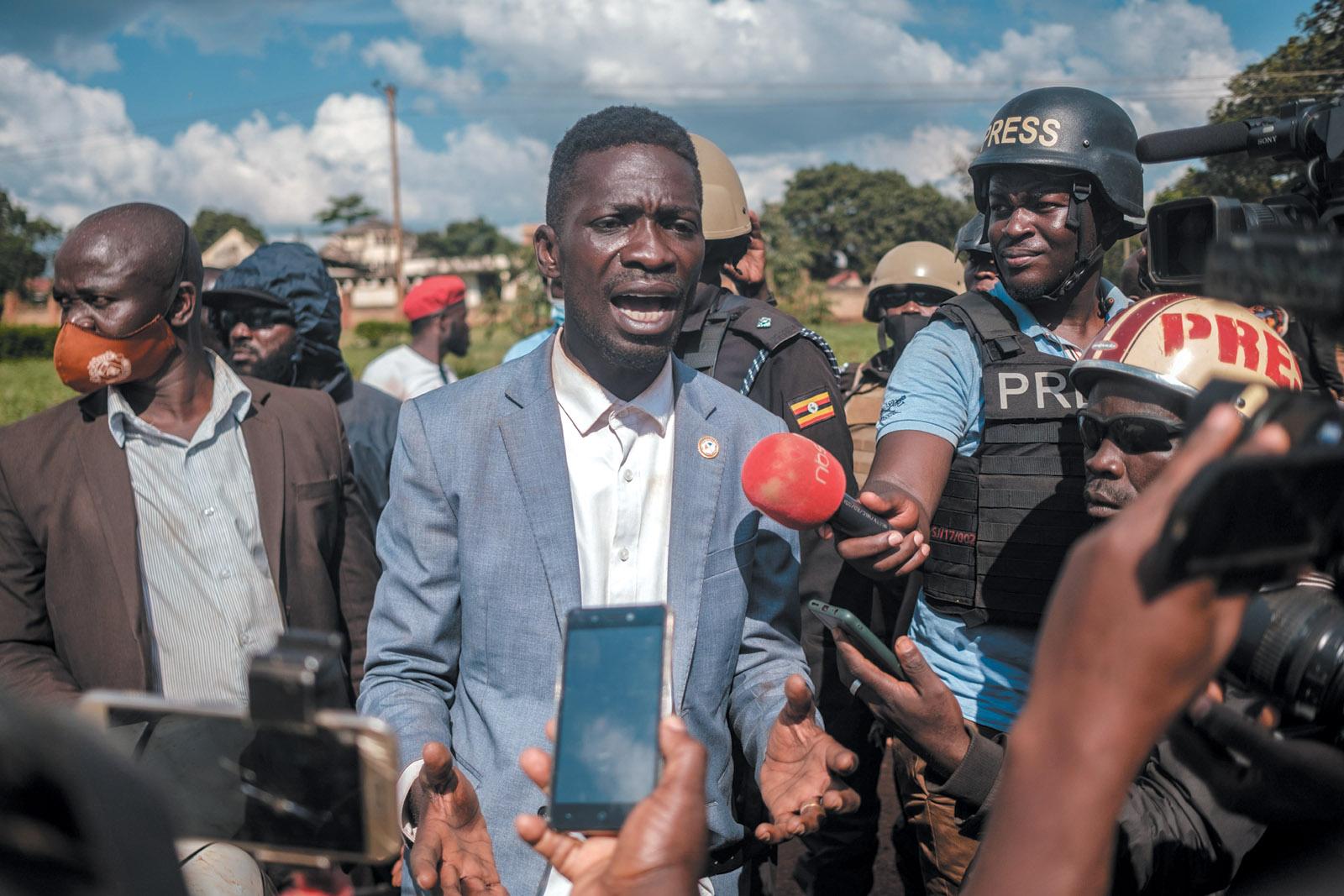 Ugandan presidential candidate Bobi Wine speaking to reporters