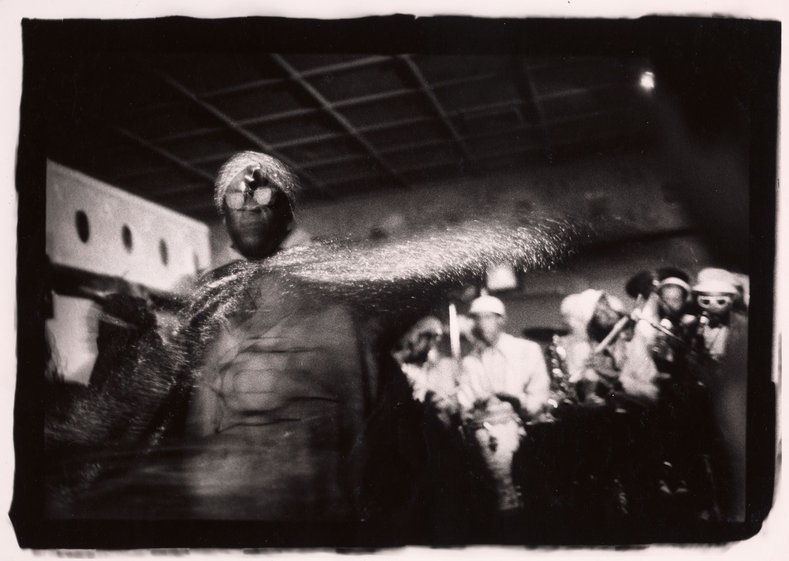 Sun Ra performing in club setting with musicians in background