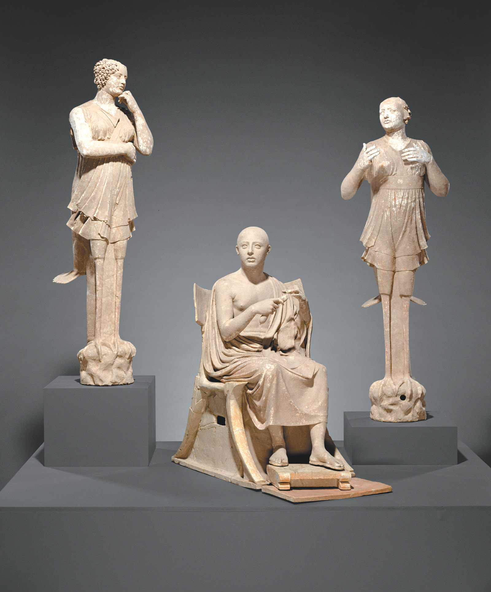 Terracotta sculptures of a seated poet and two sirens