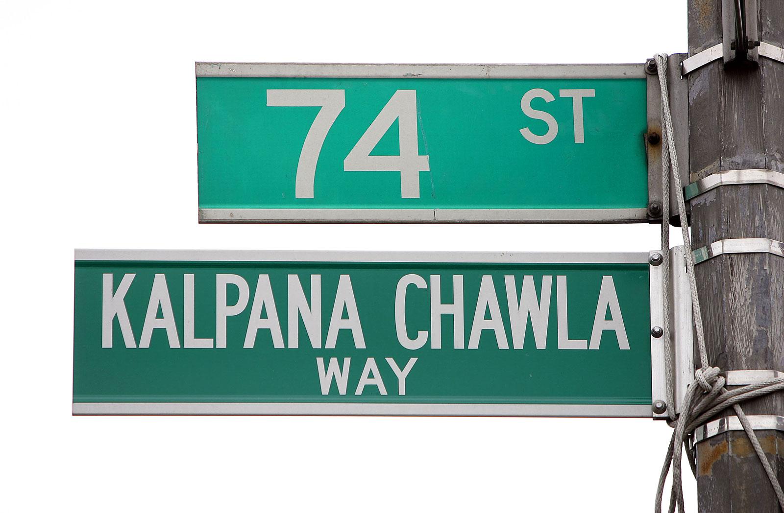 Street signs reading 74th Street and Kalpana Chawla Way