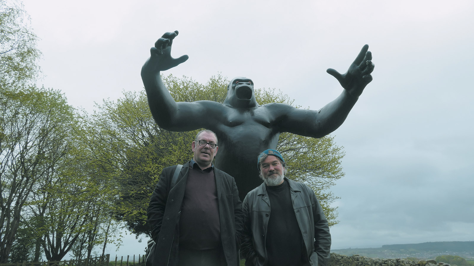 Robert Lloyd and Stewart Lee in front of Nicholas Monro's sculpture of King Kong, Cumbria, England