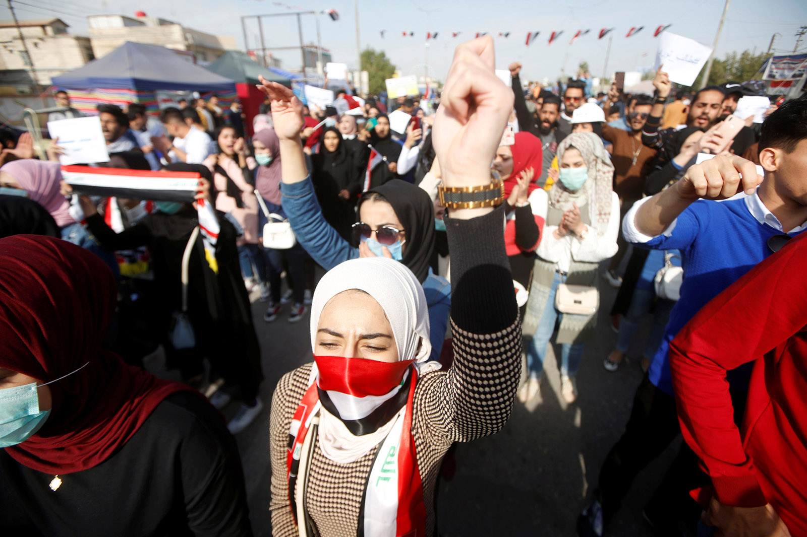 University students protesting American and Iranian intervention in Iraq