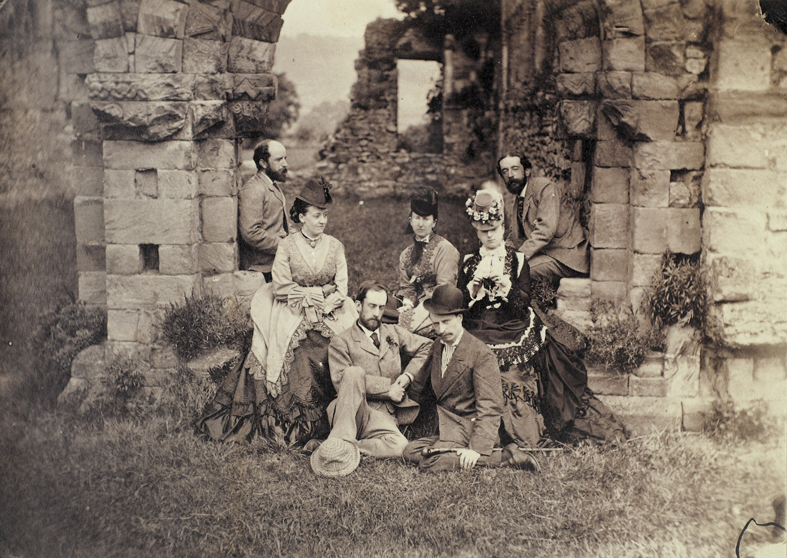 Henry Adams at Wenlock Abbey, England. The woman at the right may be his wife, Marian (Clover) Adams