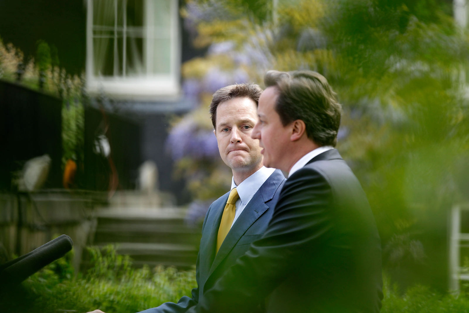 Deputy Prime Minister Nick Clegg looking on