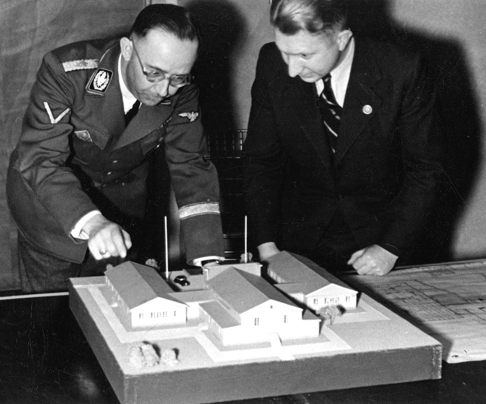 Heinrich Himmler looking at a model with Edgar Haller, who oversaw the design of soldiers' housing during the Nazi occupation of Norway