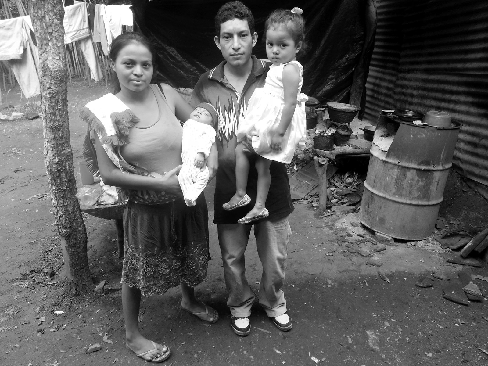 Miguel Ángel Tobar, known as the 'Hollywood Kid,' with his wife, Lorena, and their daughters, Las Pozas, El Salvador