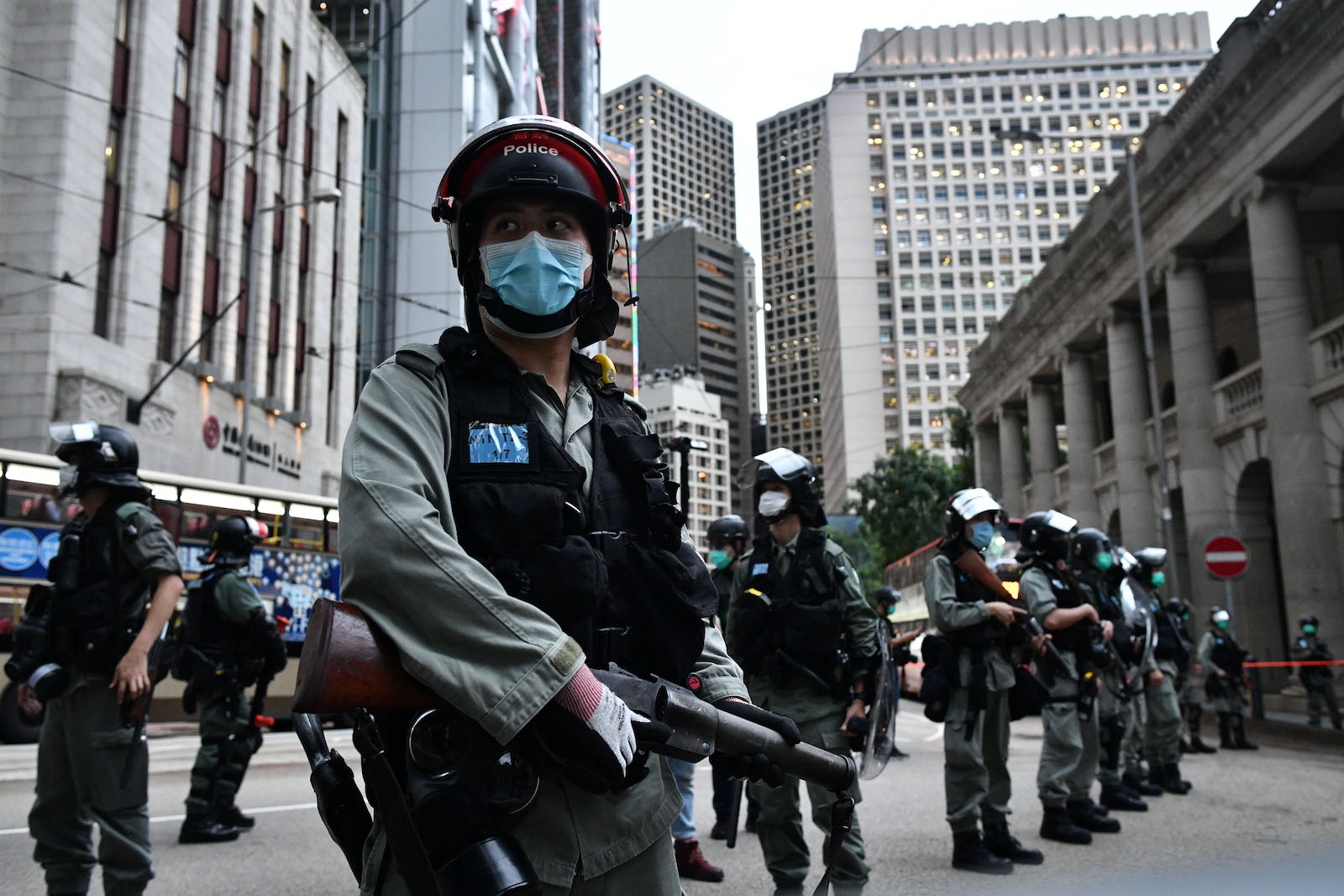 Riot police officers standing guard