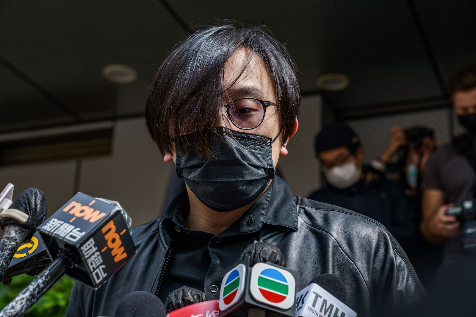 Mike Lam speaking to the press outside a Hong Kong police stattion