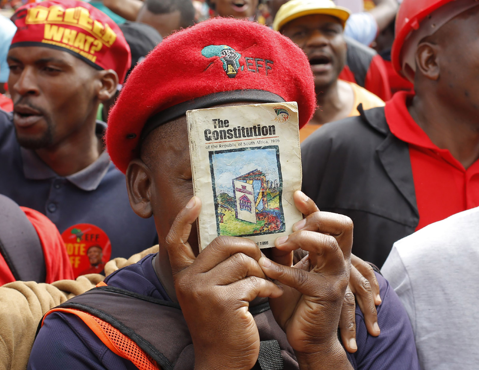 A protester holding a copy of South Africa's Constitution