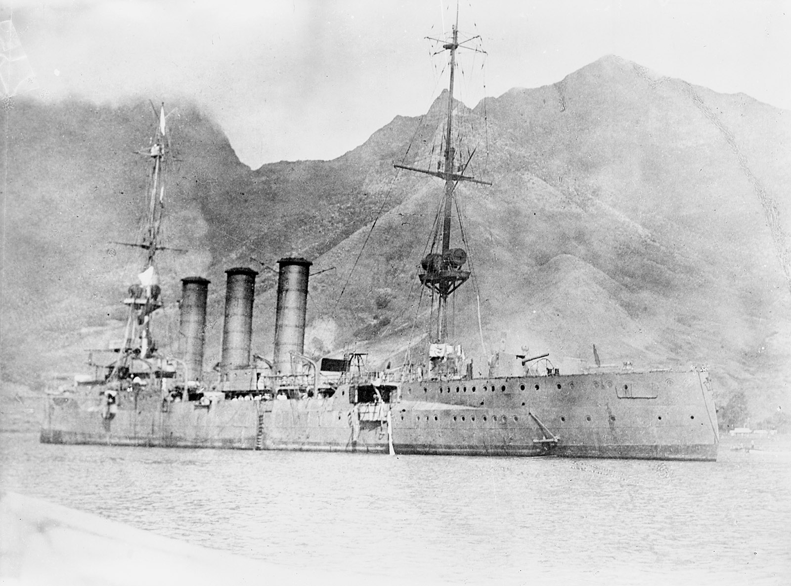 The German cruiser SMS Dresden flying a flag of surrender after being attacked by British ships off coast of Robinson Crusoe Island, Chile, 1915