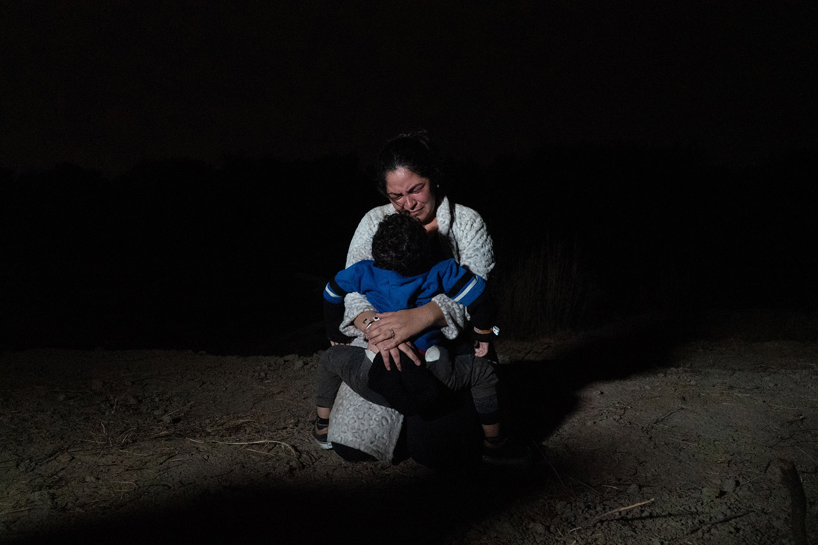 A woman and her child after crossing the Rio Grande from Mexico to the US