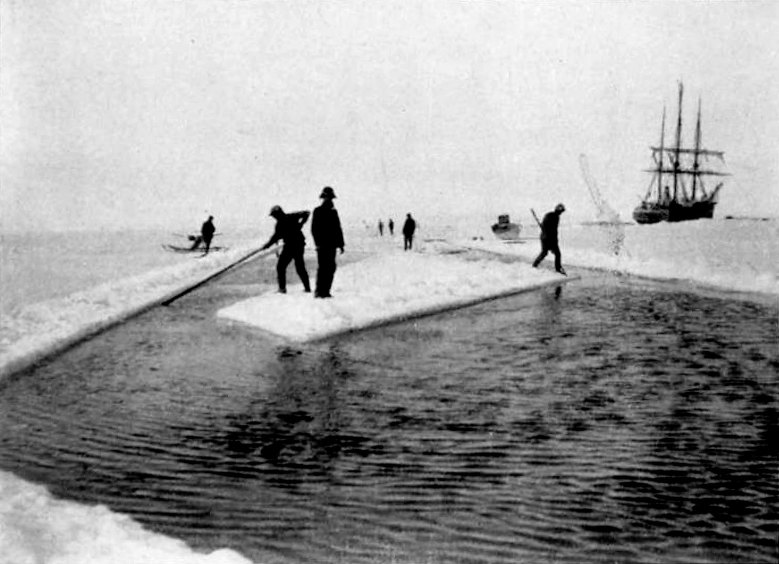 Crew members cutting a canal through the ice to free the Belgica