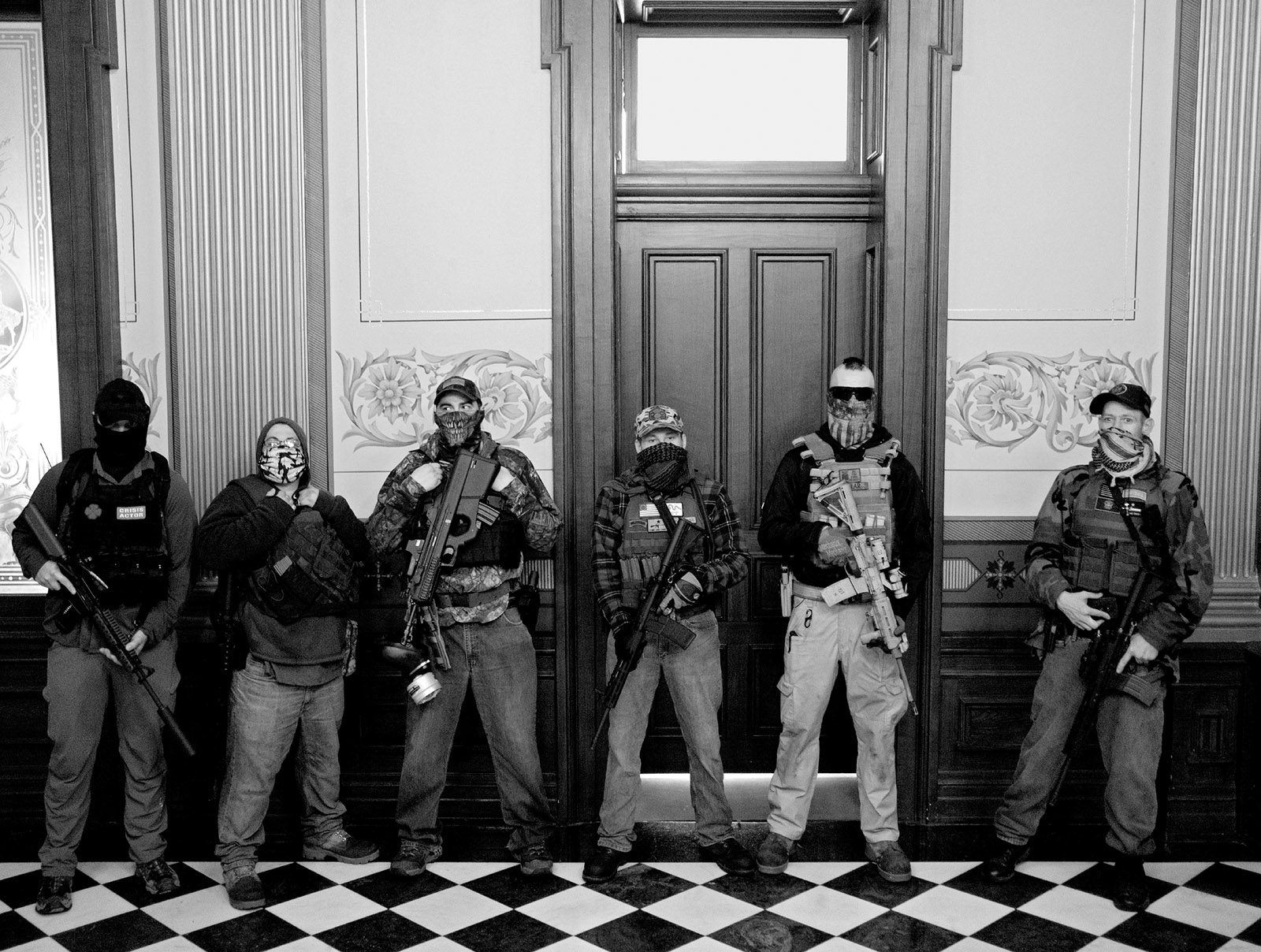 Members of a militia group outside the office of Michigan governor Gretchen Whitmer during a protest against her Covid stay-at-home order