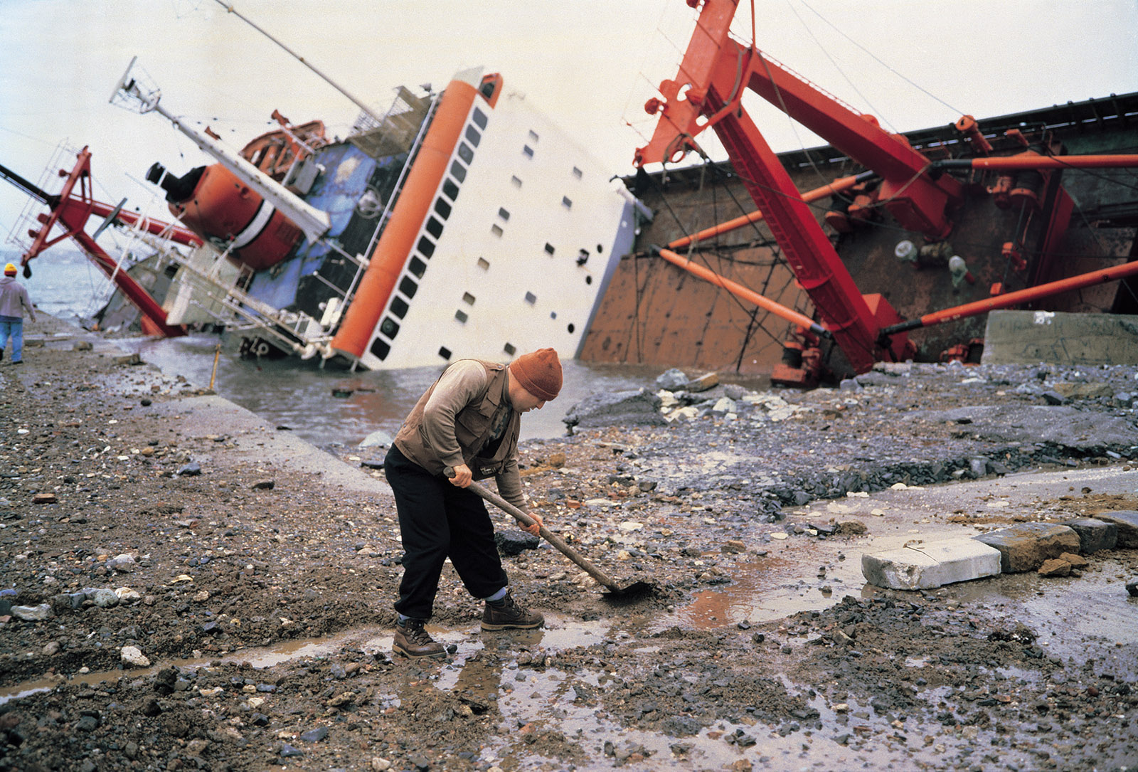 Shipwreck and worker, Istanbul; photograph by Allan Sekula