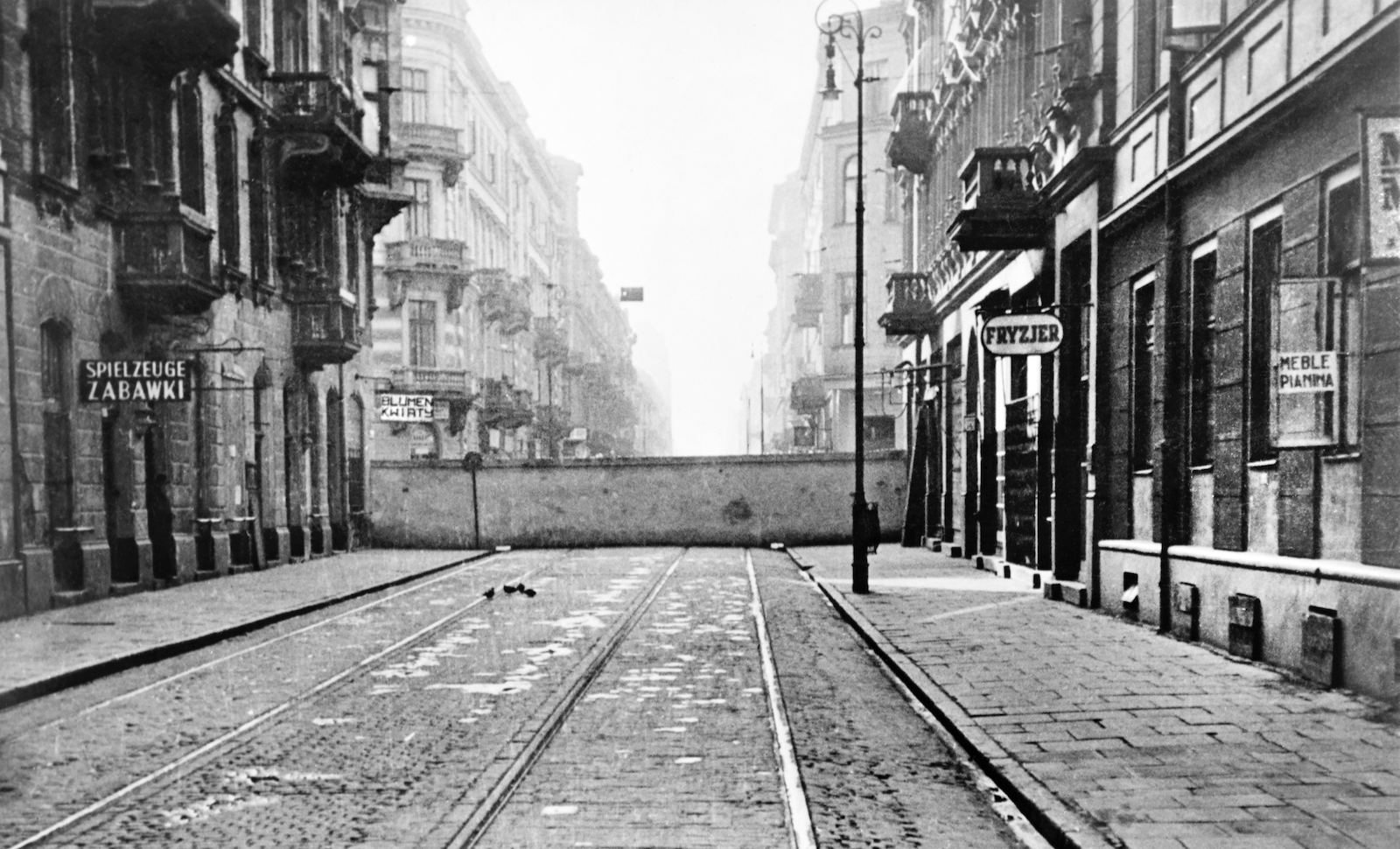 The wall encircling the Jewish ghetto, Warsaw, Poland, December 1940